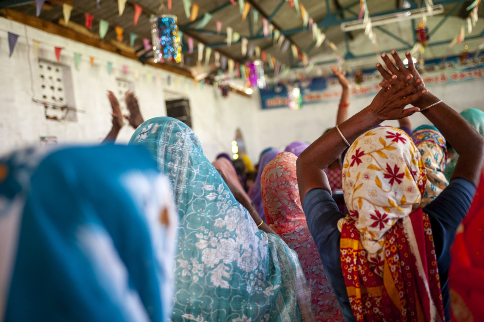 South Asians worship together during a Sunday morning service at a village church. Tsunami relief given by Southern Baptists (in 2009) gave a small fellowship voice in their community and increased their church from 12 members to over 100.